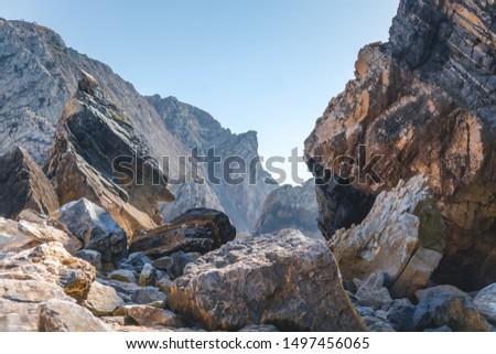 Beautiful landscape, huge grey rocks on a background of blue sky #1497456065