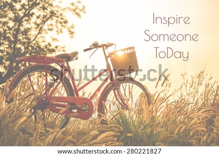 beautiful landscape image with Bicycle  at sunset  ; life quote. Inspirational quote. Motivational background