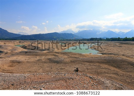 Beautiful landscape in a dried up lake in Bavaria. Kitesurfing on a lake in Allgäu