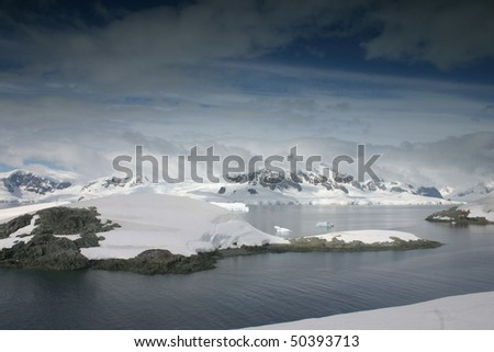 Beautiful landscape in Antarctica. Some snow covered mountains.