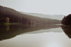 Beautiful landscape in autumn with mountains and trees reflecting on a calm lake like a mirror, Reflection on Bolu Lake TURKEY