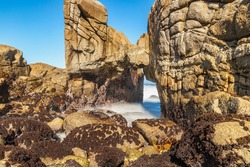 Beautiful landscape, long exposure of water, scenic coastline of Monterey, Kissing Rock view, Pacific Grove, Monterey, California, USA.