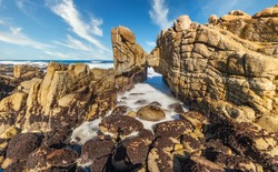 Beautiful landscape, long exposure of water, scenic coastline of Monterey, Kissing Rock view Pacific Grove, Monterey, California, USA.