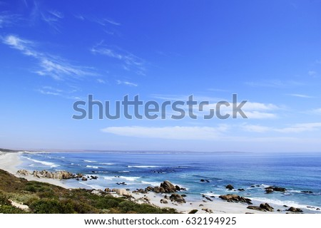 Beautiful landscape of an empty beach and calm blue ocean down the West Coast of South Africa #632194925