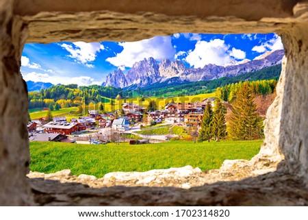 Beautiful landscape of Cortina d' Ampezzo in Dolomites Alps view through stone window, Veneto region of Italy Foto stock ©