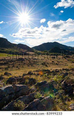 Beautiful landscape of green valley and  hills and sunshine in the blue sky in Sierra de la Ventana, Argentina