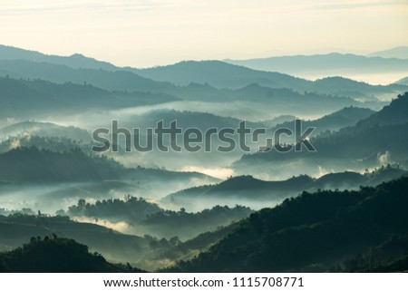 Beautiful Landscape of mountain layer in morning sun ray and winter fog at Doi Hua Mae Kham, Mae Salong Nai, Chiangrai, Thailand #1115708771