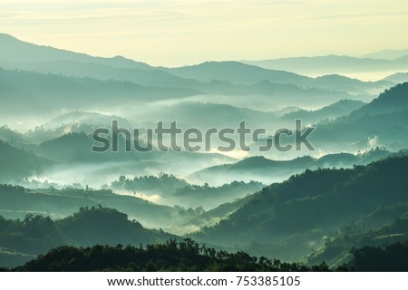 Beautiful Landscape of mountain layer in morning sun ray and winter fog at  Doi Hua Mae Kham,  Mae Salong Nai, Chiangrai, Thailand