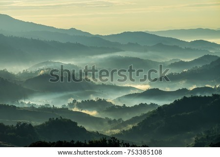 Beautiful Landscape of mountain layer in morning sun ray and winter fog at  Doi Hua Mae Kham,  Mae Salong Nai, Chiangrai, Thailand #753385108
