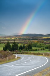 Beautiful landscape of road and rainbow in blue sky, South Island, New Zealand