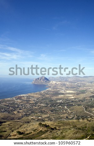 Beautiful landscape of Sicily, Italy for summer holidays - mountains, hills, meadows, blue sky and the sea. Panorama from Erice town in Agrigento province