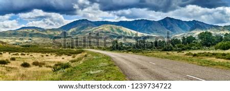 Beautiful landscape of steppe and stone mountains along the road from the city of Ust-Kamenogorsk to the Sibiny lakes (RU: Sibinskiye Ozora: Sadyrkol, Tortkara, Shalkar, Korzhynkol), East Kazakhstan