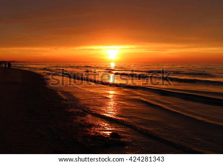 Beautiful landscape of summer sunset or sunrise and evening nature background. Rest on summer beach. Golden summer sunset. Orange summer sunset. Summer time.
