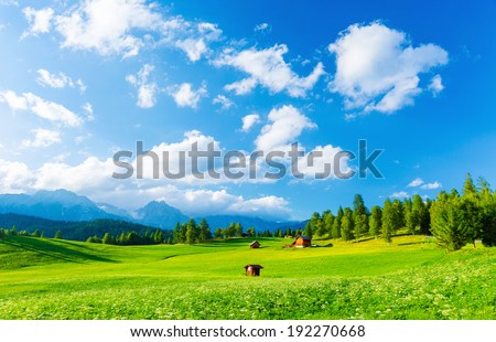 Beautiful landscape of valley in Alpine mountains, small houses in Seefeld, rural scene, majestic picturesque view in sunny day