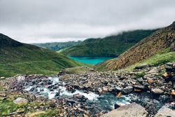 Beautiful landscape panorama of Miners Tack in Snowdonia National Park in North Wales, UK. Shoot during gloomy cloudy day with strong fog