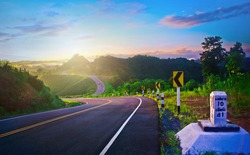 Beautiful landscape photo in highway route for background,beautiful asphalt road in the morning,Travel and driving on highway in mountains, Transportation.