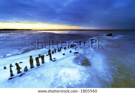 beautiful landscape photo of a frozen lake during sunset