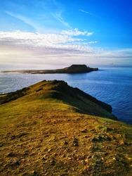 Beautiful landscape photo of Pen Pyrod island, Worms Head, The Gower in Wales, UK