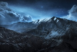 Beautiful landscape snow mountains at night on blue cloud and star background. Leh, Ladakh, India.(Double Exposure)