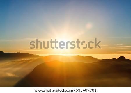 Beautiful landscape. Sunrise on the mountain chain Samanala in the clouds from Sri Pada Adam's Peak. Sri Lanka.
