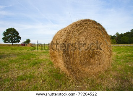 Beautiful landscape view of a farmland with hay bales