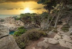 Beautiful landscape view of the hiking trail on the rocky Pacific coast at Point Lobos State Reserve in Carmel, California.