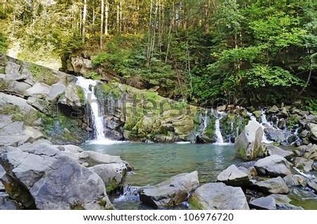 Beautiful landscape - waterfall in the Carpathian mountains