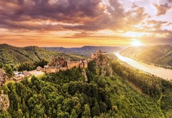 Beautiful landscape with Aggstein castle ruin and Danube river at sunset in Wachau walley Austria. Amazing historical ruins. Original german name is Burgruine aggstein. Little castle in english.