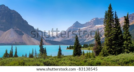 Beautiful landscape with azure blue mountain lake and famous Rocky Mountains in the background in Banff National Park, Alberta, Canada