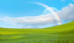 Beautiful landscape with green grass field and sun rays in the background amazing rainbow