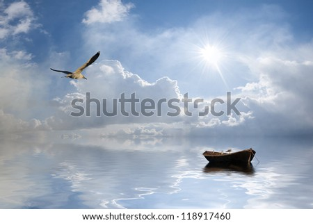 Beautiful landscape with lonely boat and birds against a sun, majestic clouds in the sky