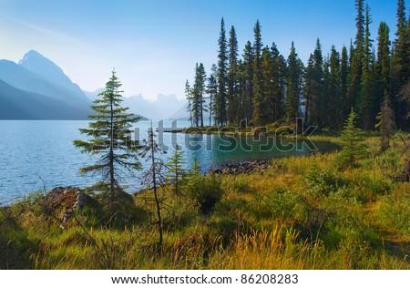 Beautiful landscape with mountain lake at dawn in Jasper National Park, Alberta, Canada