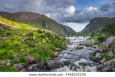 Beautiful landscape with mountain river flowing from Black Lake in Gap of Dunloe. Green hills at sunset in Black Valley, MacGillycuddys Reeks mountains, Ring of Kerry, Ireland Stok fotoğraf ©
