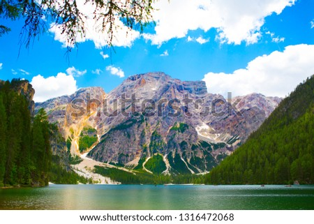 Beautiful landscape with mountains, green trees and blue sky, View from The Pragser Wildsee. #1316472068