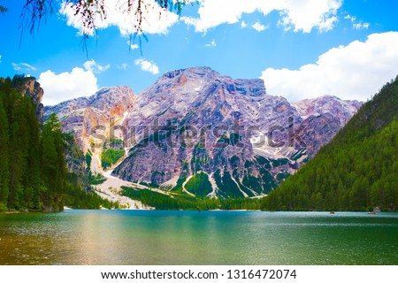 Beautiful landscape with mountains, green trees and blue sky, View from The Pragser Wildsee. #1316472074