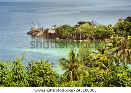 Beautiful landscape with sea bay, clear water, house of straw and palm trees