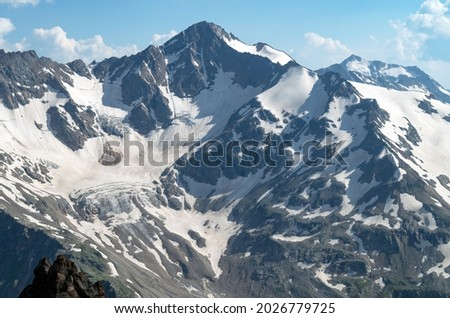 Beautiful landscape with the Caucasus mountains. Snow-capped peaks of the mountains from a height.