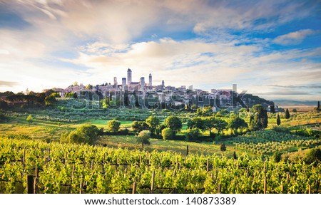 Beautiful landscape with the medieval city of San Gimignano in the background at sunset in Tuscany, province of Siena, Italy