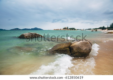 Beautiful landscape with view of ocean, perfect beach, big stones, trees, azure water. Background image. Concept  travel