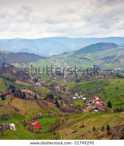 Beautiful Landscape With Village Houses And Mountains