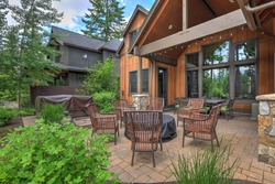Beautiful large American Northwest home  exterior with brown wood in the forest with nice parge back yard patio