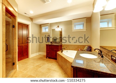 Beautiful large bathroom with two sinks and tub.