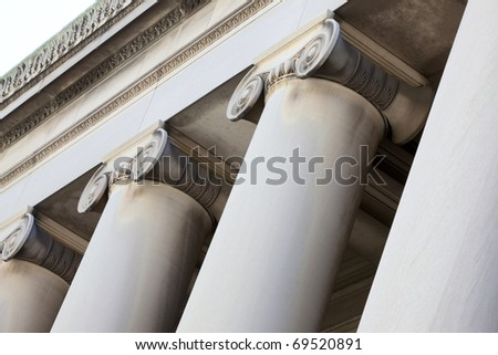 Beautiful large exterior columns made of plaster and marble