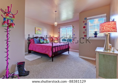 Beautiful large kids beige bedroom with pink bed