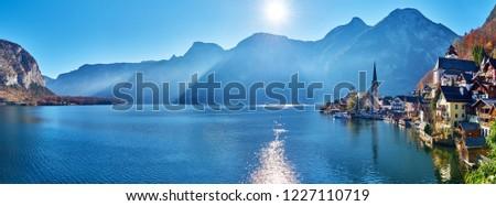 Beautiful late autumn landscape of Hallstatt mountain village with Hallstatter lake in Austrian Alps. Wide Panorama
