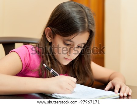 Beautiful latin girl working on her school homework