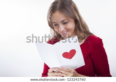 Beautiful latin woman reading a love letter on valentine's day