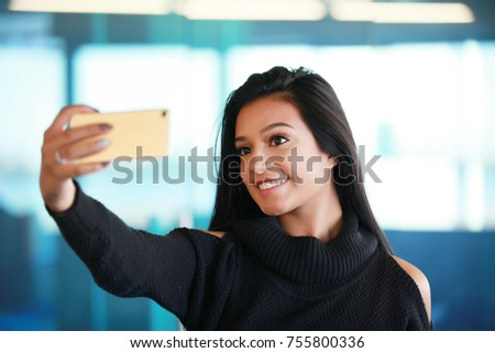 beautiful latina spanish hispanic girl taking selfie picture of herself