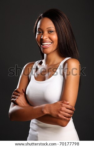 Beautiful laughing black woman in white vest