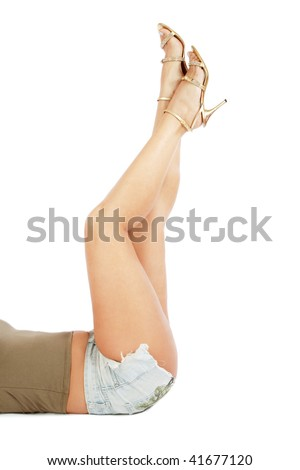 Beautiful legs of sexy plus-size woman lying on white background